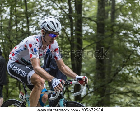 COL DU PLATZERWASEL,FRANCE - JUL 14:The Cyclist Tony Martin wears Polka Dot Jersey while climbing the road to mountain pass Platzerwasel in Vosges Mountains, during Le Tour de France on July 14 2014 - stock photo
