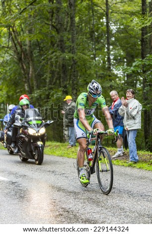 COL DU PLATZERWASEL,FRANCE - JUL 14: The Slovak cyclist Peter Sagan wearing The Green Jersey,climbs the road to mountain pass Platzerwasel, Vosges Mountains,during Le Tour de France on July 14 2014.  - stock photo