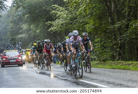 COL DU PLATZERWASEL,FRANCE - JUL 14: Tony Martin wearing Polka Dot Jersey climbing in front of the peloton, to Mountain Pass Plattzerwasel, in Vosges during Le Tour de France on July 14 2014 - stock photo