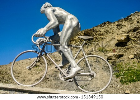 COL DU TOURMALET, FRANCE - AUGUST 21: The large statue of Octave Lapize gasping for air as he struggles to make the climb in the Tourmalet. August 21, 2013 in Col du Tourmalet, France  - stock photo