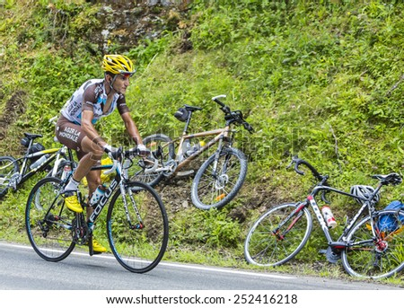 COL DU TOURMALET, FRANCE - JUL 24:The cyclist Blel Kadri (Ag2r-La Mondiale) climbing the difficult road to Col de Tourmalet in the stage 18 of Le Tour de France on July 24, 2014.He was the winner. - stock photo