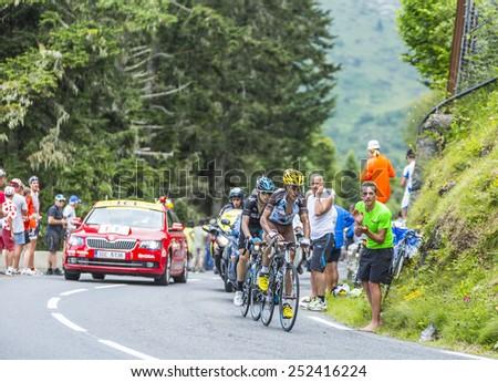 COL DU TOURMALET, FRANCE - JUL 24:The cyclists Blel Kadri (Ag2r-La Mondiale) and Nieve Iturralde (Sky) climbing the road  to Col de Tourmalet in the stage 18 of Le Tour de France on July 24, 2014. - stock photo