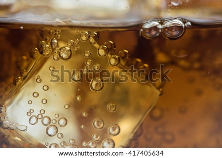 Cola and ice in a glass. - stock photo