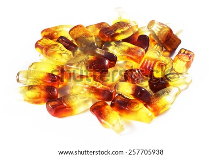 Cola flavored gummy sweet in the shape of cola bottles.Isolated on white. - stock photo