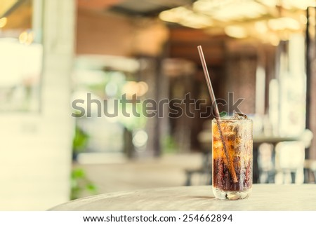 Cola glass in restaurant - vintage effect style pictures - stock photo
