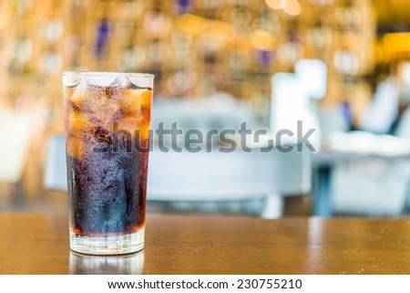 Cola glass on bokeh background - stock photo
