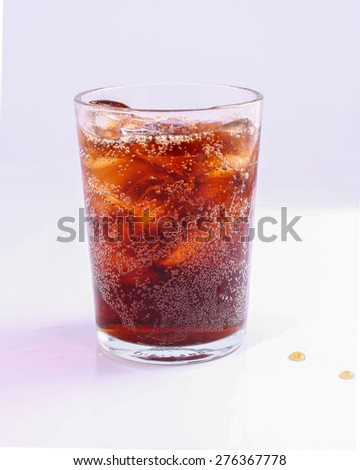 Cola glass with ice cubes over white background. - stock photo