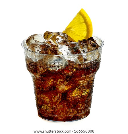 Cola in clear plastic glass with ice and lemon slice - stock photo