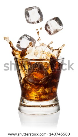 Cola in glass with falling ice cubes on white. With clipping path - stock photo
