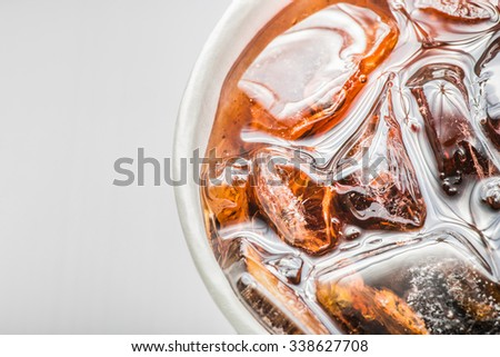 Cola in glass with ice on white background, Close up, top view - stock photo