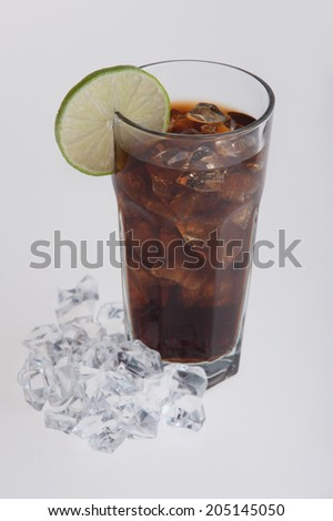 Cola in glass with lemon slice, ice cubes around the glass. Isolated on white background - stock photo