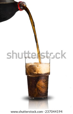 Cola Pour From Bottle to Glass - stock photo