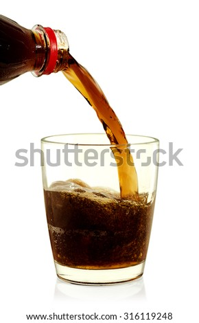 Cola pouring into glass on white background. - stock photo