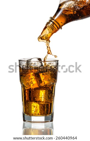 Cola splash in a glass with ice cubes - stock photo