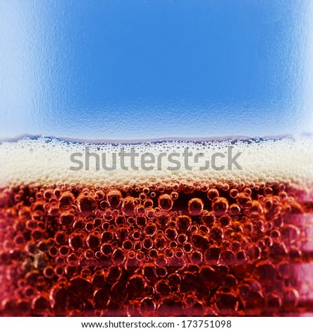 cola with bubbles and foam close up - stock photo