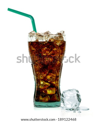 Cola with crushed ice and straw in glass on white background - stock photo
