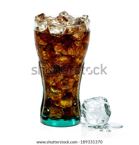 Cola with crushed ice in glass on white background  - stock photo