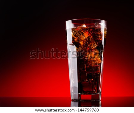 Cola with ice cubes in glass