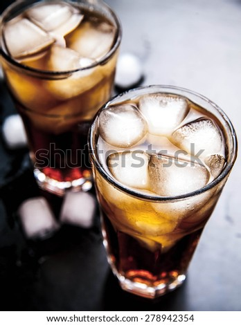 cola with ice on a wooden background. soft drinks - stock photo