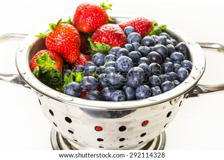 Colander with washed organic berries.