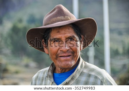 COLCA CANYON, PERU - JUNE 8, 2012: Local man with hat in the deep Colca Canyon, Peru