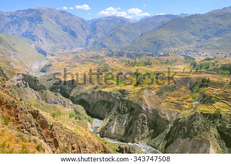 Colca Canyon, Peru, South America. Farming terraces with Pond and Cliff. One of the deepest canyons in the world. - stock photo