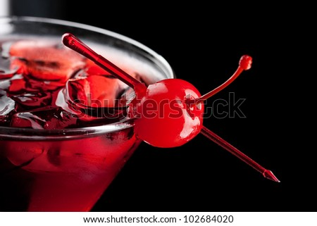 Cold alcoholic cocktail on the black background - stock photo