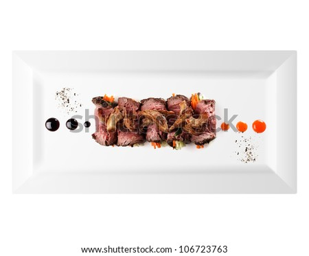 cold appetizer of meat, white background