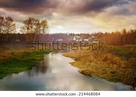 cold  autumn landscape with stormy sky - stock photo