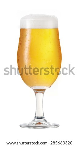 Cold beer. A glass of cold beer. Isolated on white background