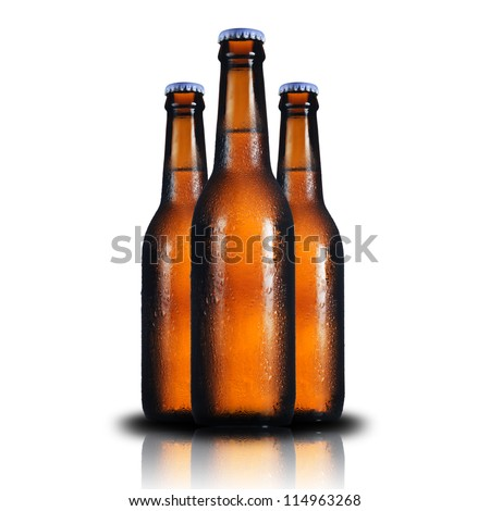 Cold 3 beer bottles on a white background. - stock photo