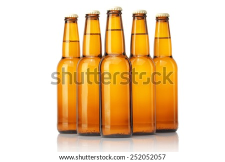 Cold  beer bottles on a white background.