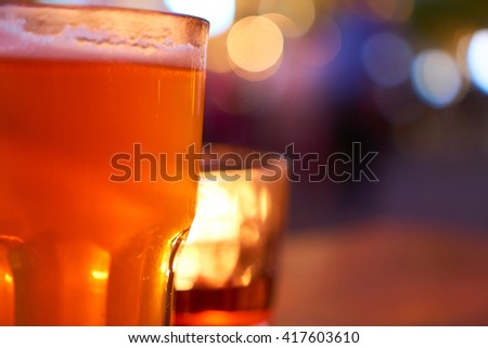 Cold beer glass with blur light bokeh background - stock photo