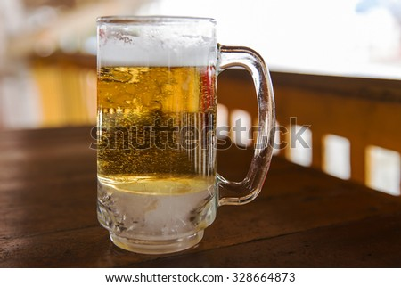 Cold beer in the glass with blur and soft focus