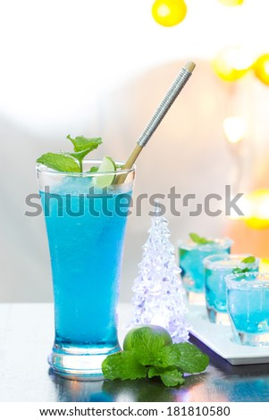 Cold Blue Hawaiian cocktail in a night party. - stock photo