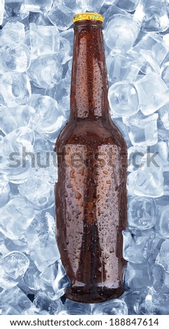 cold bottle of beer frozen in ice - stock photo