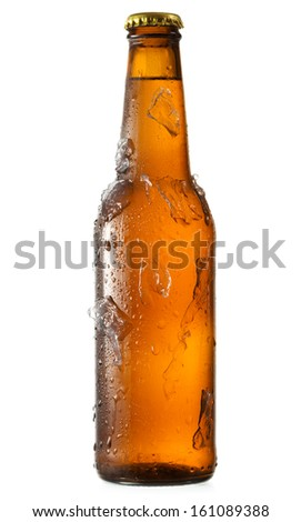 cold bottle of beer with ice on white background - stock photo