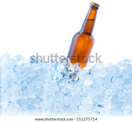 Cold brown bottle of beer in the ice cubes. Isolated on white.