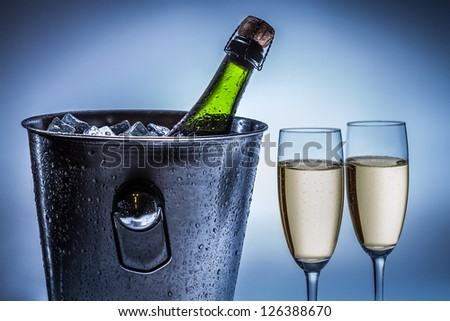 Cold chilled champagne in ice bucket - stock photo