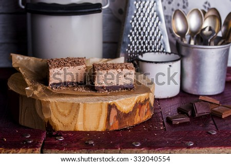 Cold chocolate cheesecake with cottage cheese on wooden background