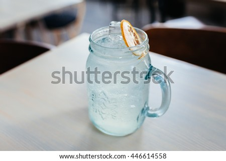 Cold cocktail with lime - stock photo