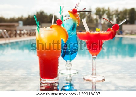 Cold cocktails on the background of the pool