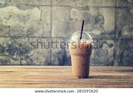 Cold Coffee On Wood,vintage filter - stock photo