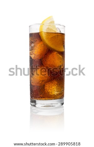 cold cola in a glass with dew drops and lemon slice  - stock photo