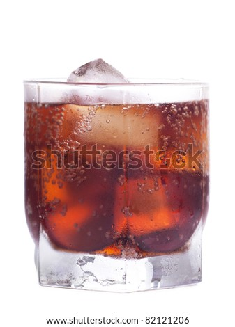 Cold cola in a glass with ice cubes over white background - stock photo
