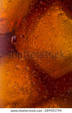 cold cola with dew drops and ice  - stock photo