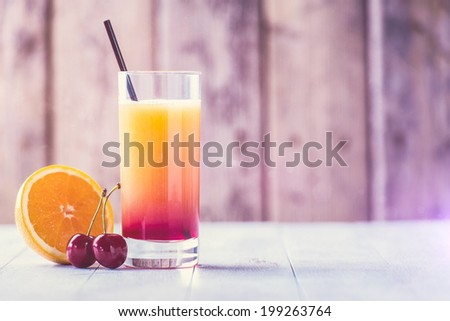 Cold colorful cocktail drink on a hot summer day - stock photo