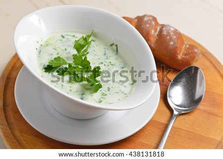 cold cucumber soup garnished with fresh parsley