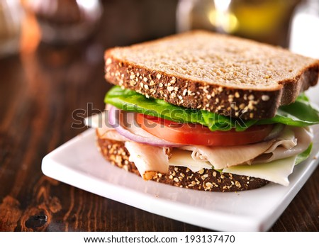 cold cut turkey sandwich on whole wheat with swiss cheese - stock photo