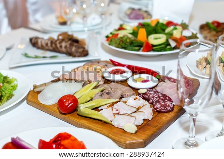 cold cuts on a banquet table